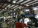 308_Work_trucks_on_hoists_for_new_engines